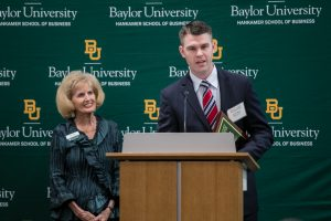 Metallic Products' Travis Wendt accepts the Heritage Award at Baylor University's Family Business of the Year Awards